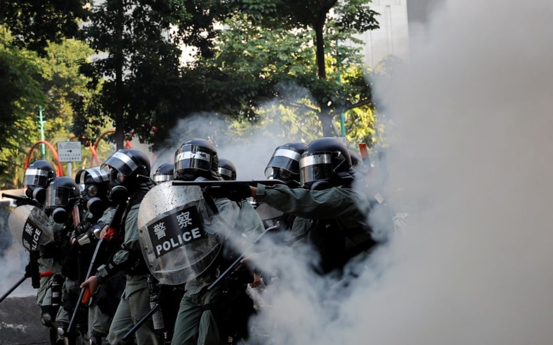 Hong Kong protester shot with live round during China National Day rally